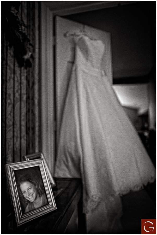 Marian's high school portrait in front of her beautiful wedding dress.